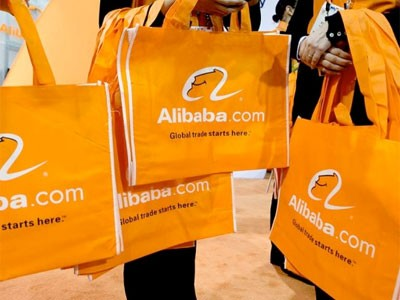 Alibaba orange shopping bags. The company has almost single-handedly turned China into the world's second-largest e-commerce market. Photo: Bloomberg