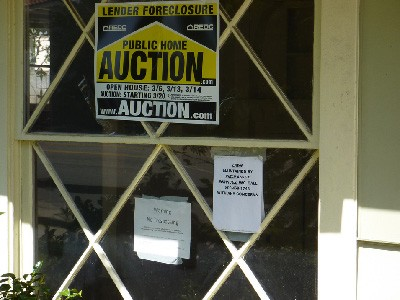 foreclosed home auction sign