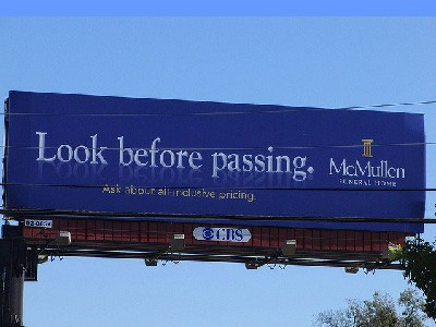 Look before passing funeral ad