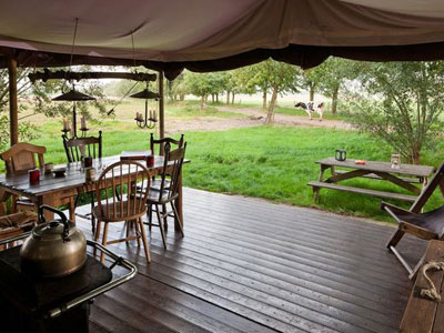 Glamping tent with table and chairs