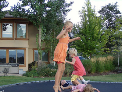 Real estate business basics kids on trampoline
