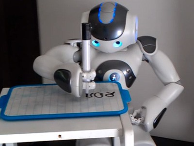 NAO Robot writing on a pad