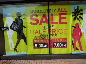 Sales signs in store window