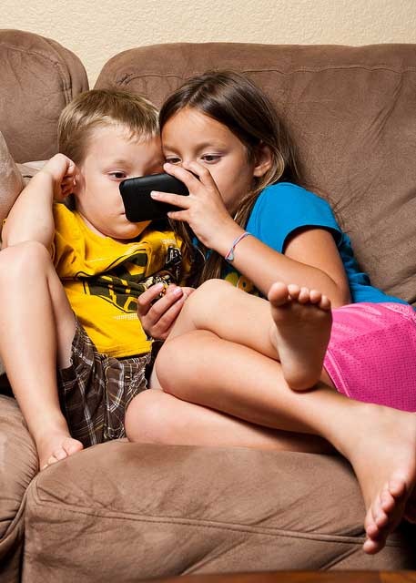 Kids watching Netflix on a phone