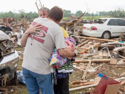 Tornado couple hug ABCNews