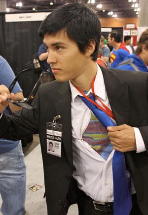 Clark Kent shows his Superman shirt under his dress shirt