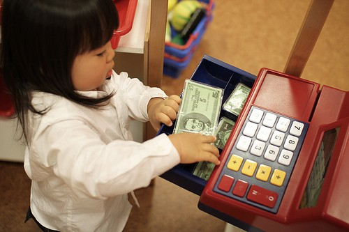girl with play money