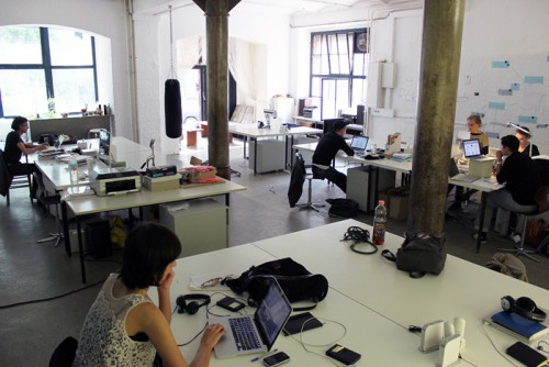 A coworking space in Berlin, via Wikipedia.