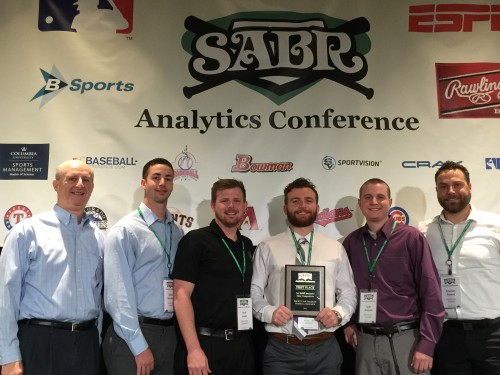 W.P. Carey School of Business students David Bocchino, Sean Aronson, Cody Callahan, Reid Smith and Emerson Frostad receive the top prize for the Diamond Dollars Case Competition from SABR President Vince Gennaro.