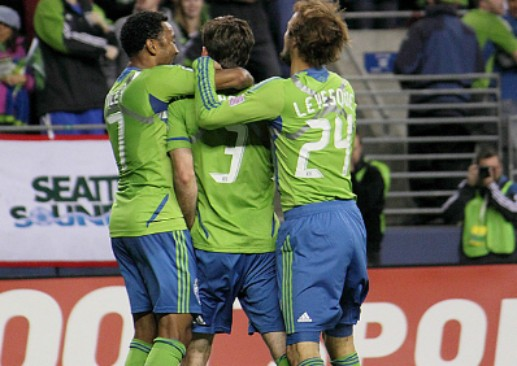 The Seattle Sounders celebrate during a match against Toronto FC. (Via Flickr.com)