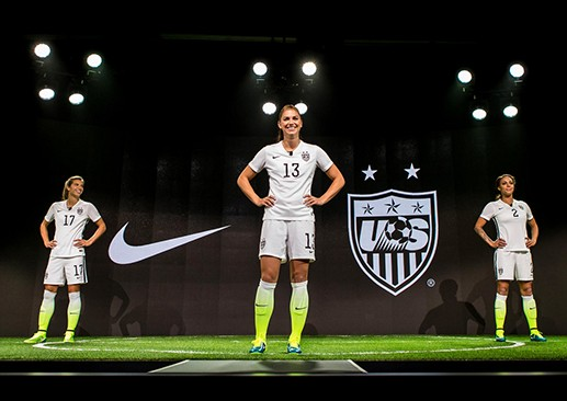 U.S. Women's soccer star Alex Morgan (center) shows off Nike's designs for the national team's home kit for the World Cup. (Photo courtesy of Nike.com)