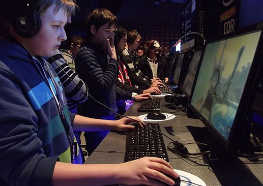 Gaming and eSports attract fans from around the world, like these players at an Intel Extreme Masters tournament in Poland. (Photo via Flickr user Piotr Drabik)