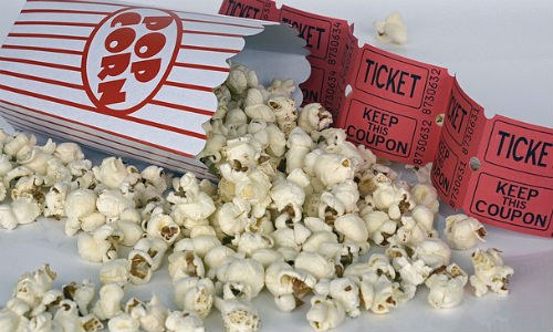 "Movie theaters are combatting sinking sales with luxury service and immersive experiences. (""Popcorn"" image by ""annca"" via Pixabay)"