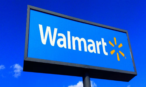 """""""Wal-Mart lured more shoppers during the quarter, but profits fell as the retailer invested heavily to compete with Amazon."""" (""""Wal-Mart"""" Photo courtesy of Flickr user Mike Mozart)."""