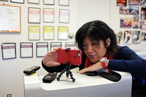 Government and Political Reporter Amy Wu makes a smartphone video.