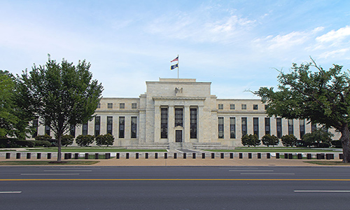 Members of the Fed are divided on what the effects of some of President Trump's economic policies may be.
