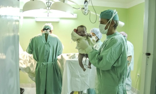 Doctor holding a newborn baby