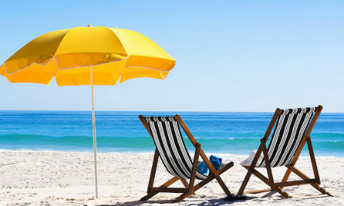 """As summer travel season approaches, here are six must-read articles to inspire your own reporting. (""""Beach chairs on Sand"""" image by """"williamsthomas310"""" via flickr CC BY 2.0)"""