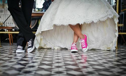 Bride and groom wearing Converse sneakers