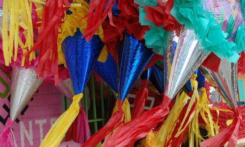 "Proposed tariffs on Mexican wares will have an impact on American purchasers—not just of pinatas, but big-ticket items such as computers and applicances. (""East Los Angeles"" image by Ralph Hockens via Flickr, CC By 2.0)"