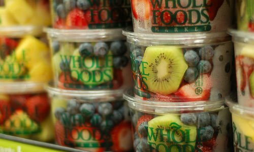 "Albertsons may be planning a bid for Whole Foods Markets, USA Today reported. (Image ""Whole Foods 1"" by Britt Reints via Flickr, CC BY 2.0)"