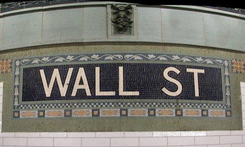 The footnotes in public companies' SEC filings are full of great leads for business journalists. (Wall Street Subway Station image by Michael Daddino via Flickr, CC BY 2.0)