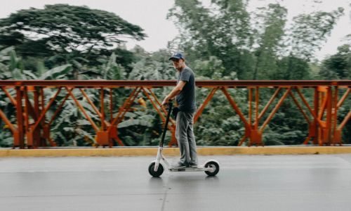 adult on a scooter